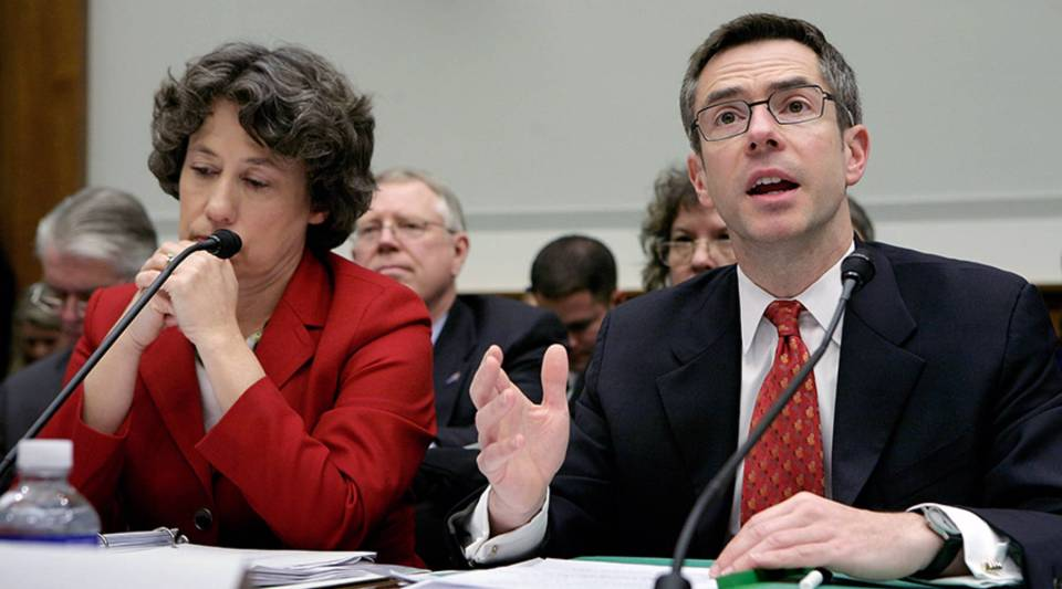 Randall Kroszner of the Federal Reserve System Board of Governors (R) testifies before the House Financial Services Committee along with Federal Deposit Insurance Corporation Chairman Sheila Bair on Capitol Hill Dec. 6, 2007 in Washington, D.C. The committee held the hearing about accelerating loan modifications, improving foreclosure prevention and enhancing enforcement in an effort to stem damage from the subprime mortgage crisis.