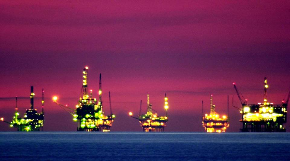 Night comes to oil and gas platforms near the Federal Ecological Reserve in the Santa Barbara Channel, Feb. 15, 2001, near Santa Barbara, California.