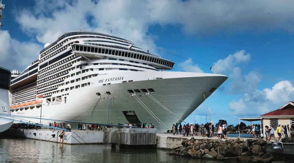 Tourists arrive from a cruise ship in St. John's, Antigua, in December. While its sister island Barbuda was nearly destroyed in Hurricane Irma, Antigua was left relatively untouched.