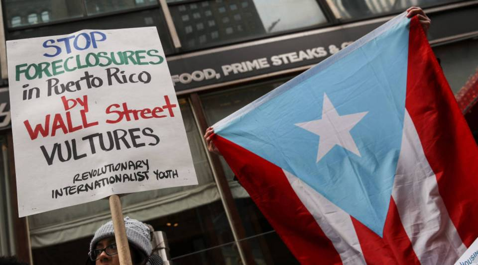 Protesters rally against foreclosures on Puerto Rican families affected by Hurricane Maria, outside the offices of TPG Capital, Dec. 20, 2017 in New York City. The activists claims that TPG Capital's mortgage service companies are aggressively foreclosing on families in Puerto Rico after many people were displaced from their homes following Hurricane Maria.