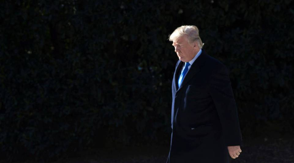 US President Donald Trump walks to Marine One prior to departing from the South Lawn of the White House in Washington, DC, January 5, 2018, as he travels for a weekend with Republican lawmakers at Camp David in Maryland.