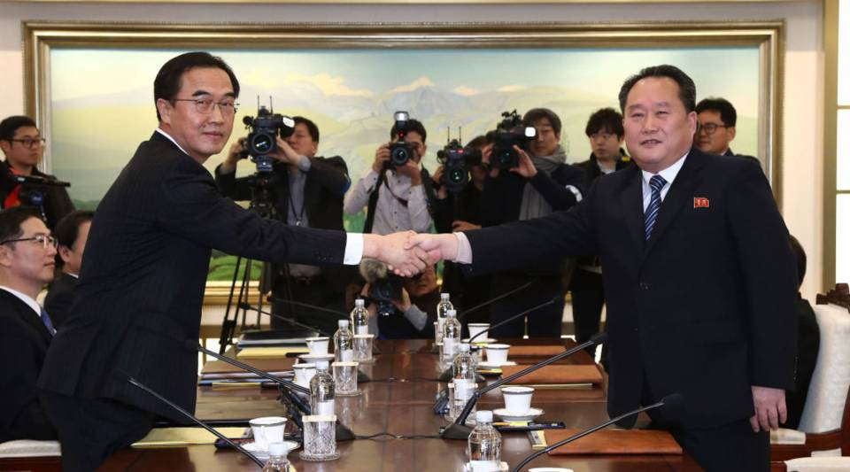 South Korean Unification Minister Cho Myoung-gyon (L) shakes hands with the head of North Korean delegation Ri Son-Gwon (R) before their meeting at the Panmunjom in the Demilitarized Zone on Jan. 9, 2018 in Panmunjom, South Korea. South and North Korea are scheduled to begin their first official face-to-face talks in two years.