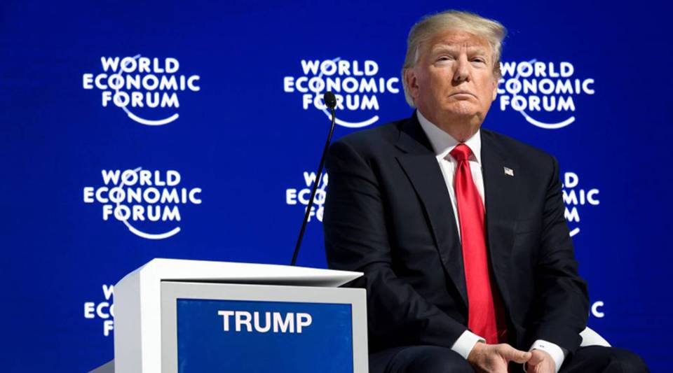President Donald Trump looks on after delivering his speech to the World Economic Forum annual meeting today in Davos, Switzerland.