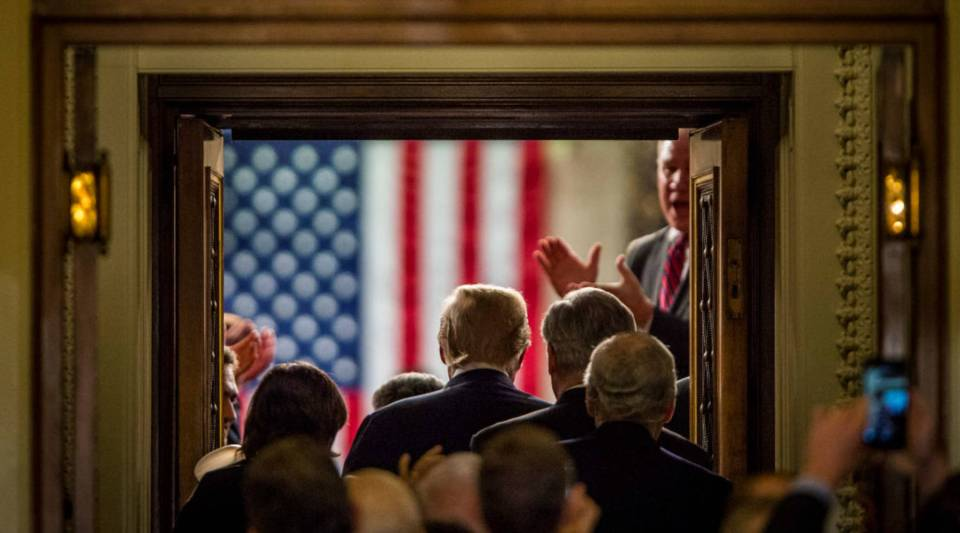 President Donald Trump enters the House of Representatives chamber to deliver his first State of the Union address before a joint session of Congress on Tuesday in Washington, D.C.