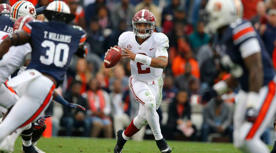 Jalen Hurts #2 of the Alabama Crimson Tide looks to pass during the first quarter against the Auburn Tigers at Jordan Hare Stadium on November 25, 2017 in Auburn, Alabama.