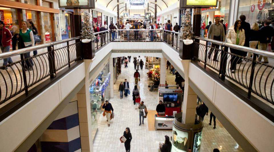 Shoppers are packed into Tysons Corner Center, a mall in suburban Washington.