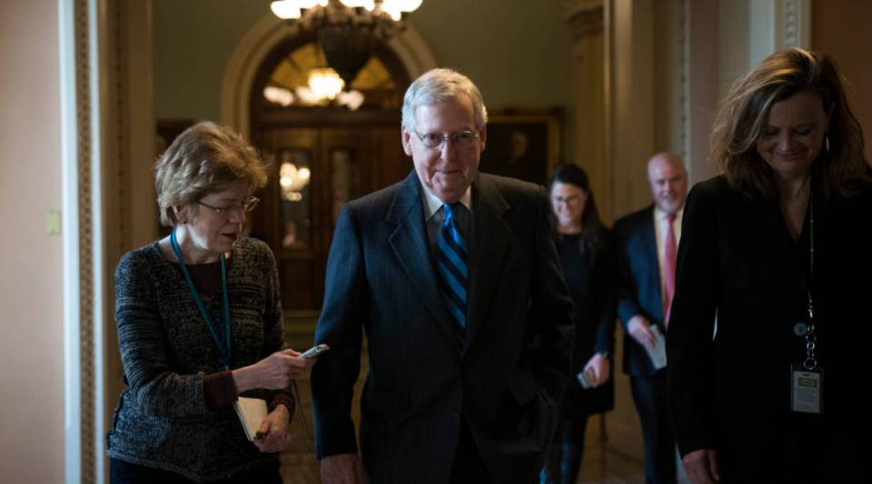 Senate Majority Leader Mitch McConnell (R-KY) leaves the Senate floor and walks to his office on Capitol Hill, January 21, 2018 in Washington, D.C.