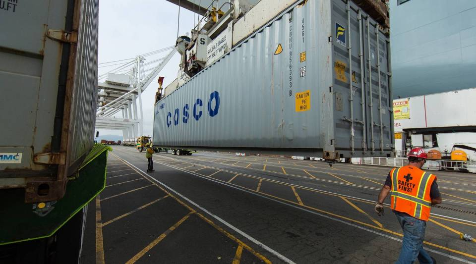 Longshoremen working on the ship COSCO Denmark at a non-automated terminal at the Port of Long Beach in 2010.