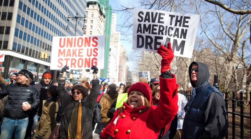 Demonstrators rally in front of city hall in solidarity with union workers across the country on February 26, 2011 in New York City.