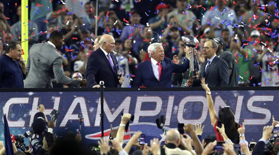 New England Patriots owner Robert Kraft raises the Lombardi Trophy after defeating the Atlanta Falcons during the 2017 Super Bowl in Houston.