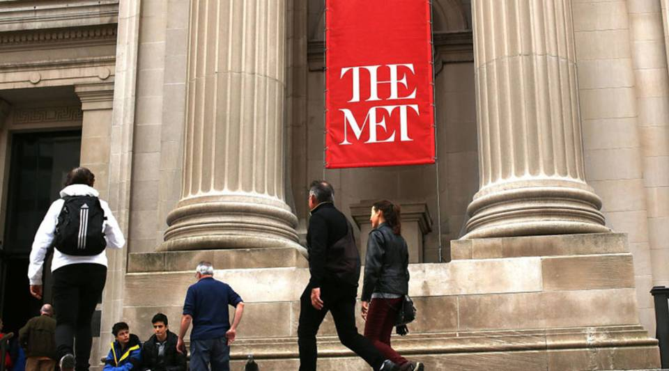 People congregate at the entrance to the Metropolitan Museum of Art (Met) on March 1, 2017 in New York City.