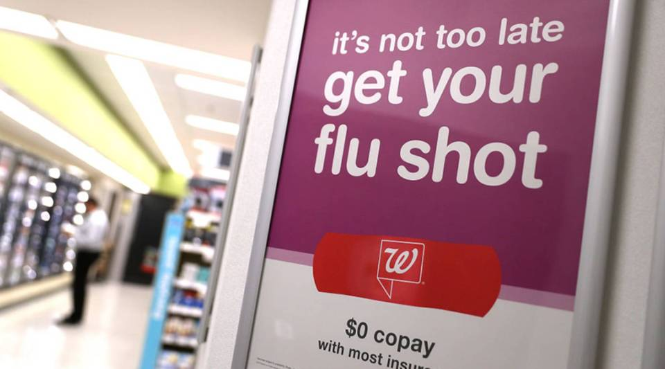 A sign advertising flu shots is displayed at a Walgreens pharmacy on Jan. 22, 2018 in San Francisco, California.
