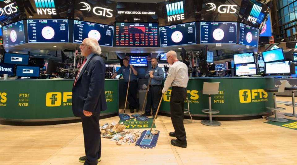 Personnel sweep the floor after the closing bell of the Dow industrial average at the New York Stock Exchange today.
