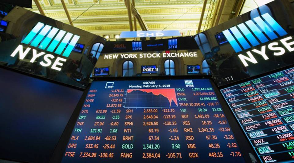 The closing numbers are displayed after the closing bell of the Dow Industrial Average at the New York Stock Exchange yesterday.