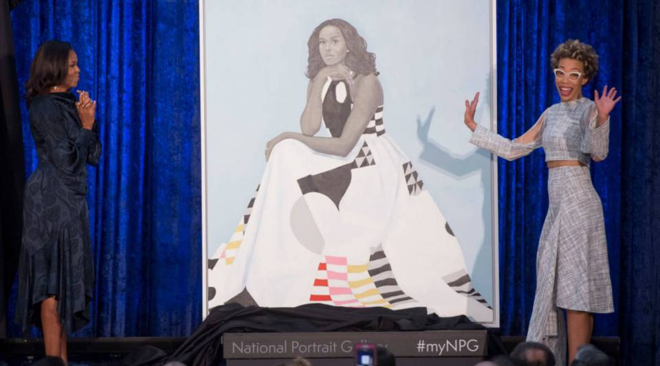 Former First Lady Michelle Obama, left, and artist Amy Sherald unveil Obama's portrait at the Smithsonian's National Portrait Gallery in Washington, D.C., Monday.