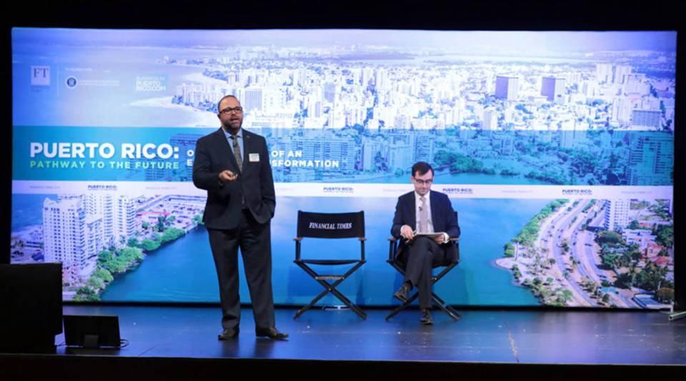 Department of Economic Development and Commerce Secretary Manuel Laboy, left, speaks onstage during the Pathway to the Future: Opportunities of an Economic Transformation Forum at PlayStation Theater on Feb. 15 in New York City. Top Puerto Rico government officials announced that Puerto Rico is open for business.