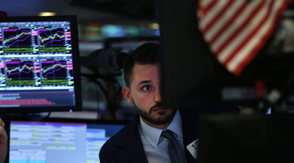 """The U.S. doesn't always do the right thing,"" says Adam Posen, president of the Peterson Institute for International Economics. ""But on average, it both tries to do the right thing and professes to do the right thing more credibly than anybody else."" Above, a trader works on the floor of the New York Stock Exchange."