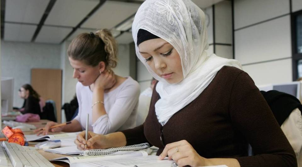 A Muslim woman attends an office management class in Berlin.