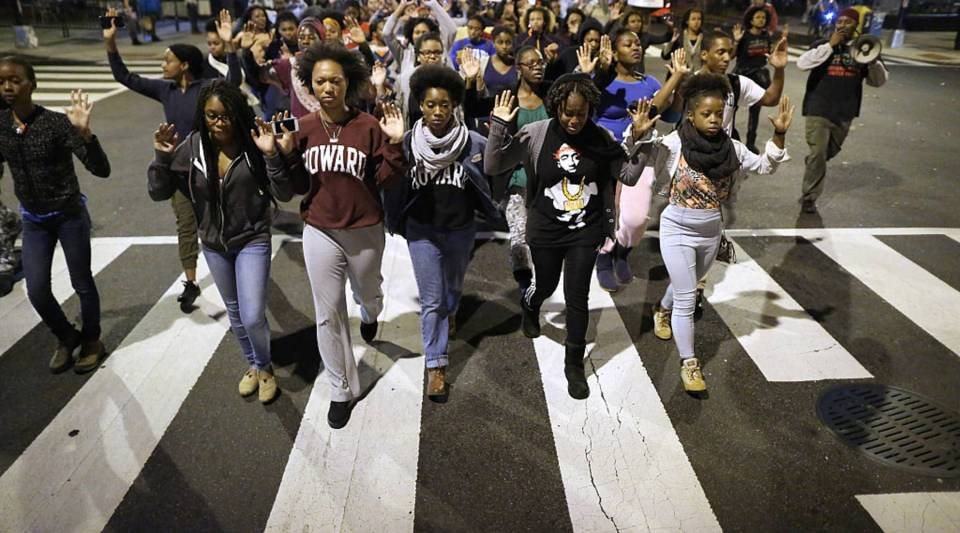 Hundreds of demonstrators, many of them Howard University students, march down the middle of U Street Northwest after a grand jury did not indict Darren Wilson, a white police officer, for killing Michael Brown, an unarmed black teenager.