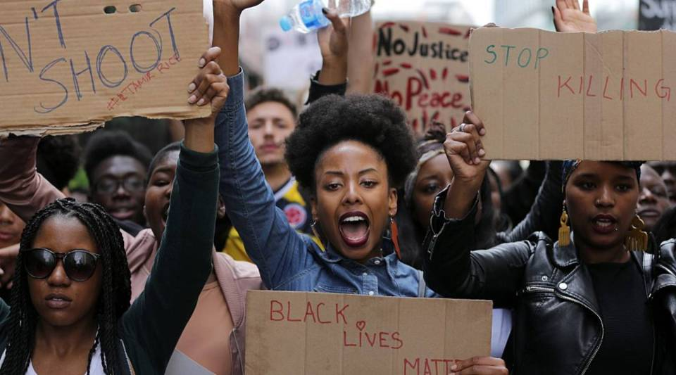 Demonstrators from the Black Lives Matter movement march during a demonstration against the killing of black men by police in the U.S.