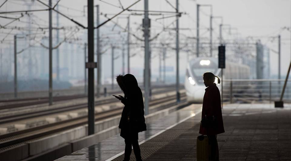 Passengers await a bullet train on the platform at Changzhou North railway station.
