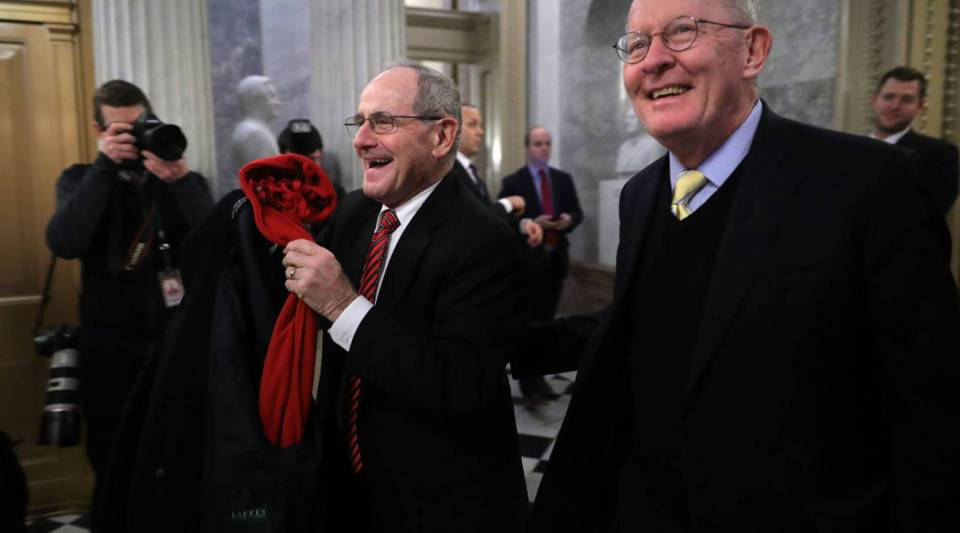Sen. James Risch (R-ID) (L) and Sen. Lamar Alexander (R-TN) leave the U.S. Capitol following early morning votes on Friday in Washington, D.C. Despite an attempt by Sen. Rand Paul (R-KY) to slow down the process, the Senate passed bipartisan legislation to continue to fund the government and lift strict budget caps.