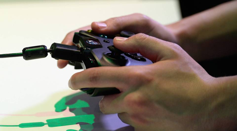 An Xbox One controller is used at the Microsoft Xbox booth during the Electronics Expo 2013 at the Los Angeles Convention Center on June 11, 2013 in Los Angeles, California.