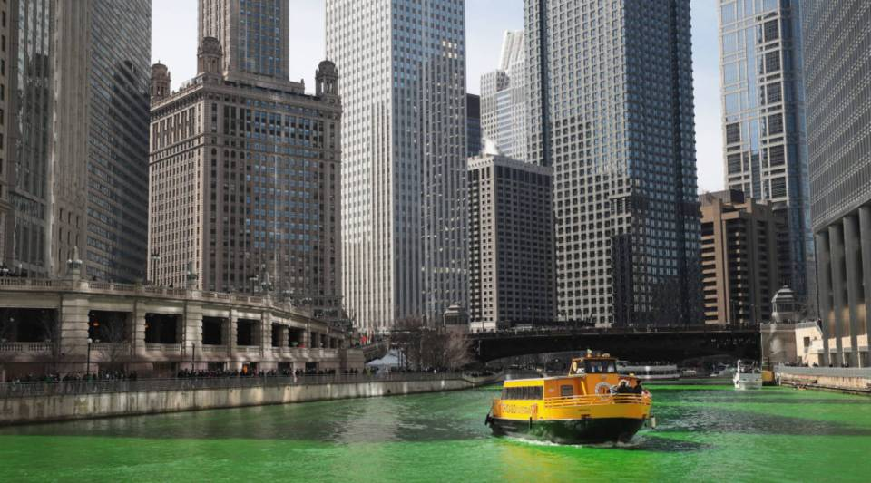 Awater taxi navigates the Chicago River shortly after it was dyed green in celebration of St. Patrick's Day on March 11, 2017 in Chicago, Illinois.