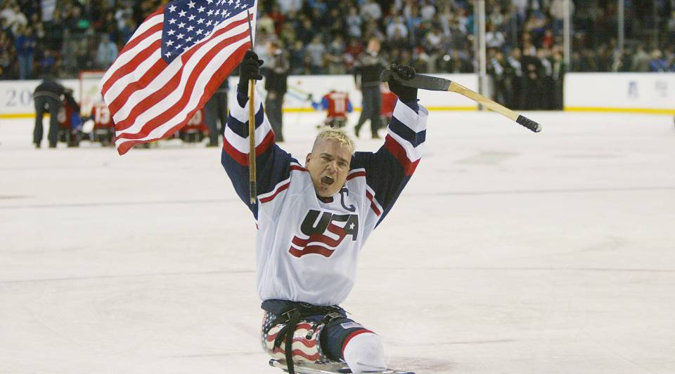 Joe Howard of the United States celebrates a gold-medal win against Norway in sledge hockey during the Salt Lake City Winter Paralympic Games in Utah in 2002.