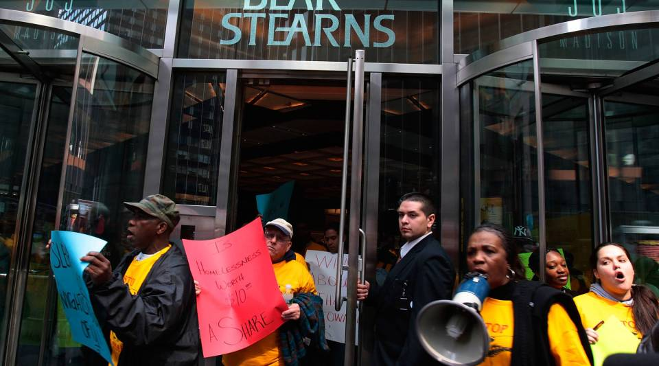 Protestors walk out of the lobby of the Bear Stearns headquarters March 26, 2008 in New York. Hundreds of housing activists overwhelmed security and stormed the lobby of the Bear Stearns skyscraper in Manhattan, staging a noisy rally and protesting the government-backed sale and bailout of the investment bank.