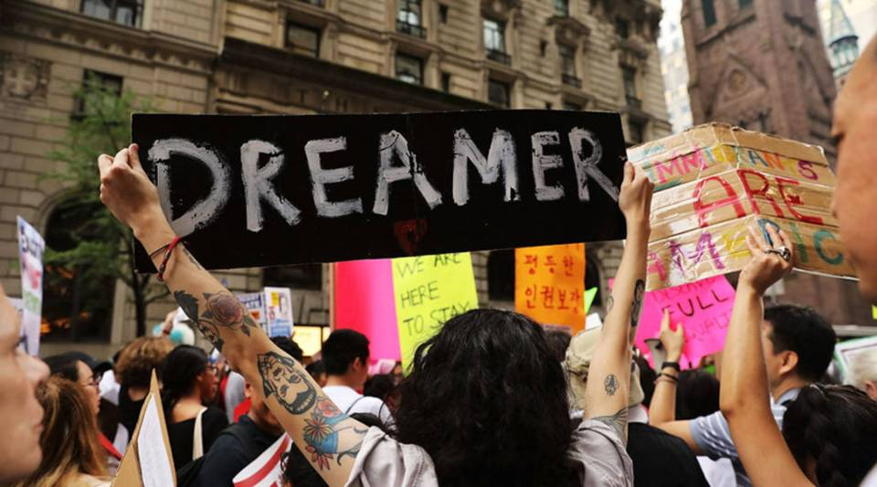 Dozens of immigration advocates and supporters attend a rally outside of Trump Tower along Fifth Avenue in August  in New York City.