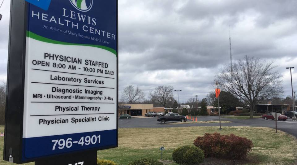 A sign lets Lewis County residents know the hours and offerings. Another sign on the building instructs patients to call 911 if the facility is closed for the night.
