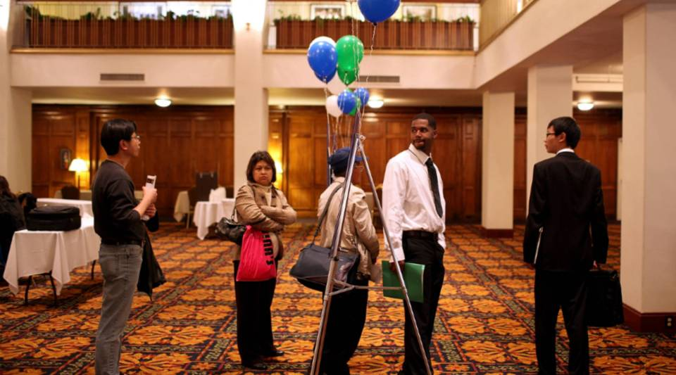 Job seekers wait in line to have their resumes reviewed during a job fair in San Francisco.