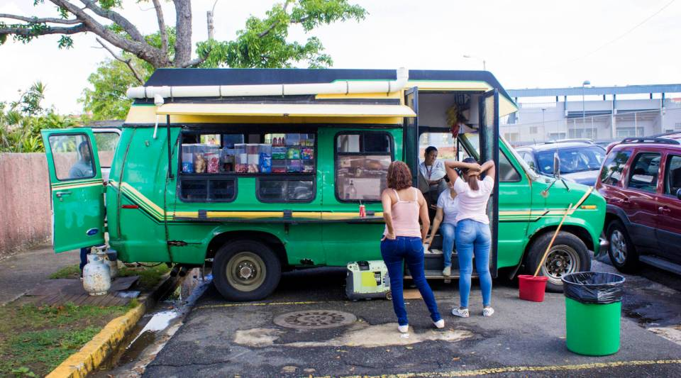 """Since 1987, the food truck formally named """"Love Pizza"""" has operated outside of Escuela Elemental John F. Kennedy, an elementary school in Toa Baja, Puerto Rico slated to close this summer. Students and parents call the truck """"Maggie's Food Truck."""""""