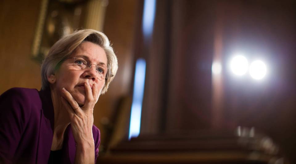 Sen. Elizabeth Warren (D-MA) listens to testimony from witnesses during a Senate Banking, Housing and Urban Affairs Committee hearing.