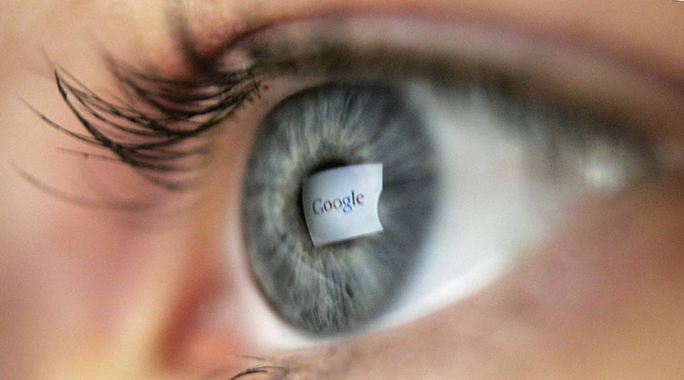 In this photo illustration, the logo of the multi-faceted internet giant Google is reflected in the eye of a woman looking at a computer screen, April 13, 2006 in London, England.