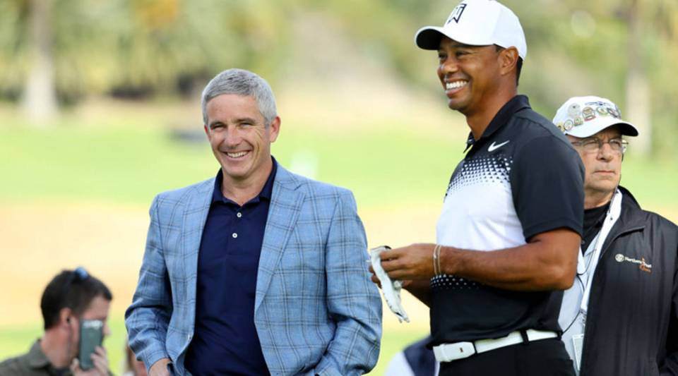 PGA Commissioner Jay Monahan (L) meets with Tiger Woods during the Pro-Am of the Genesis Open at the Riviera Country Club on February 14, 2018 in Pacific Palisades, California.
