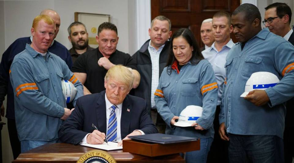 US President Donald Trump signs Section 232 Proclamations on Steel and Aluminum Imports in the Oval Office of the White House on March 8, 2018, in Washington, DC.