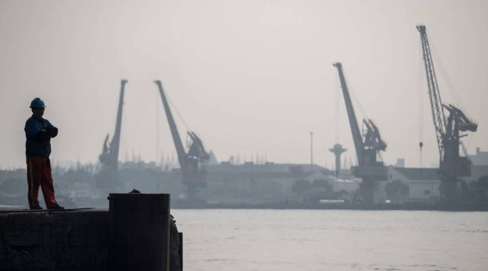 A worker standing at a dock of a port in Shanghai on March 22, 2018.