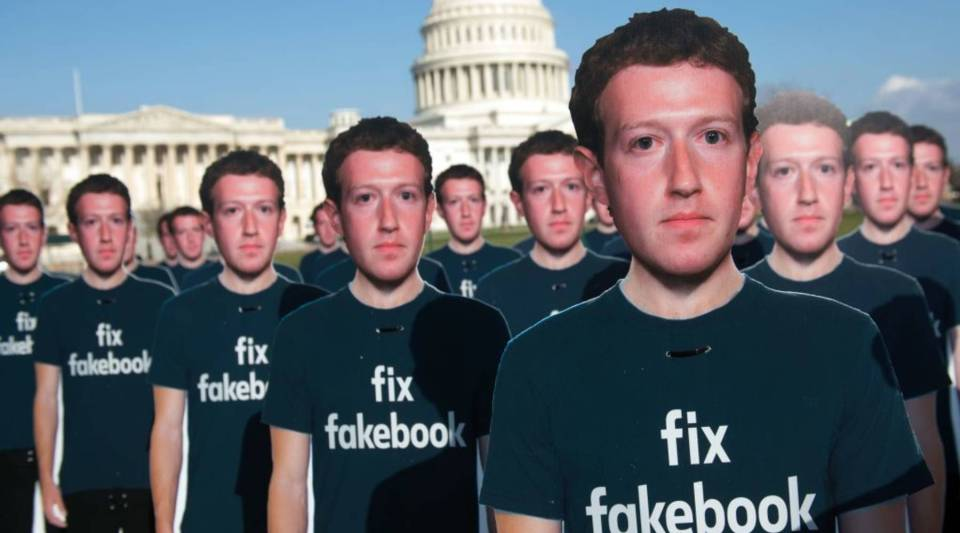 One hundred cardboard cutouts of Facebook founder and CEO Mark Zuckerberg stand outside the US Capitol in Washington, DC, April 10, 2018. Advocacy group Avaaz is calling attention to what the groups says are hundreds of millions of fake accounts still spreading disinformation on Facebook.