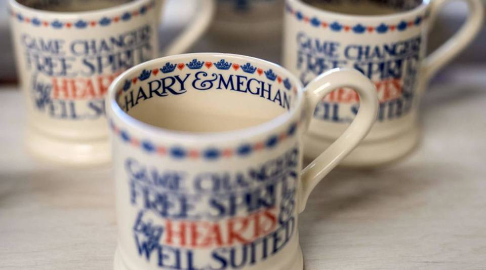 Hand-painted commemorative mugs, with a message celebrating the forthcoming wedding of Britain's Prince Harry and his U.S. fiance Meghan Markle, are displayed at the Emma Bridgewater factory in Stoke-on-Trent, central England, on April 16.