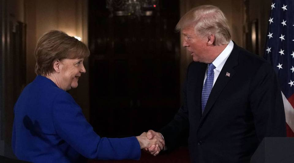 U.S. President Donald Trump (R) shakes hands with German Chancellor Angela Merkel (L) during a joint news conference at the East Room of the White House April 27, 2018 in Washington, D.C.