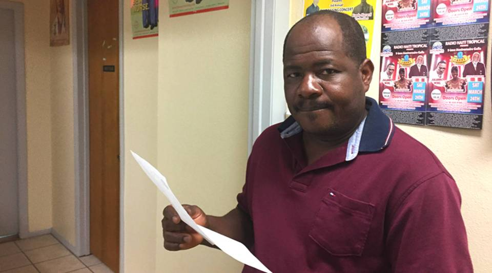 Reynald Justance earns a living working in the kitchens at Disney World. He sends money to family and friends in Haiti at least once a week.