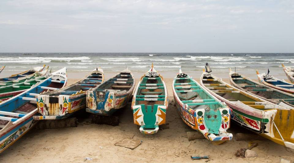 A beach in Dakar is full of unused pirogues, or wooden fishing boats. Senegal loses an estimated $300 million a year as a result of competition from foreign industrial trawlers that fish off its coast.