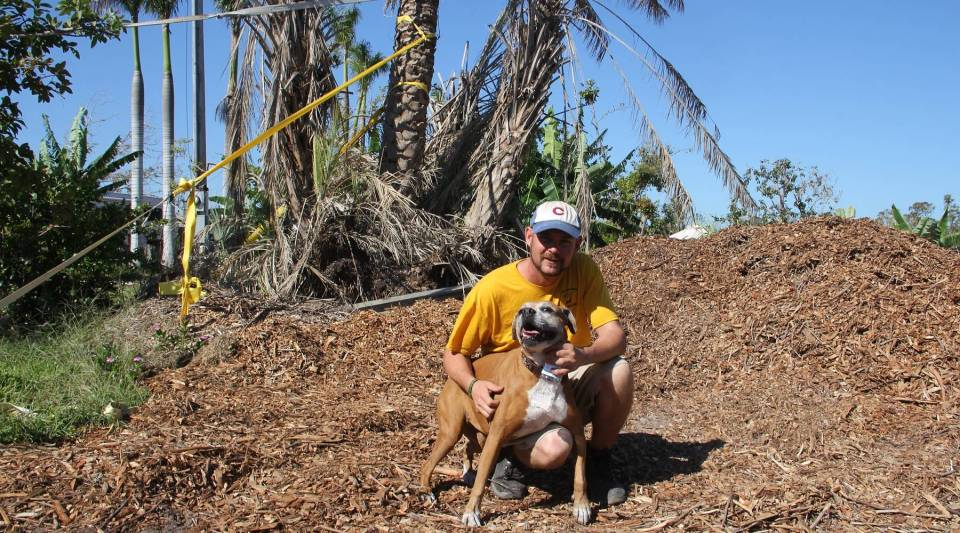 Patrick Garvey with his dog, Bella, who rode out Hurricane Irma in the Keys with him. Garvey and Bella are living in a camper on the Grimal Grove property while his wife and twin 4-year-old daughters are staying with family in Brazil.