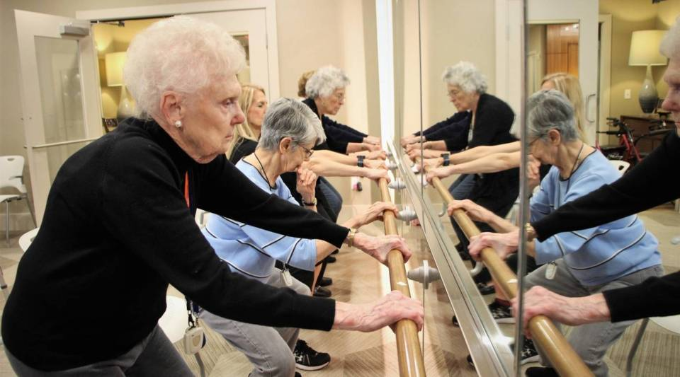 Marilyn Oliver (far left), 89, attends barre class with other Avanti Senior Living residents, in Houston.