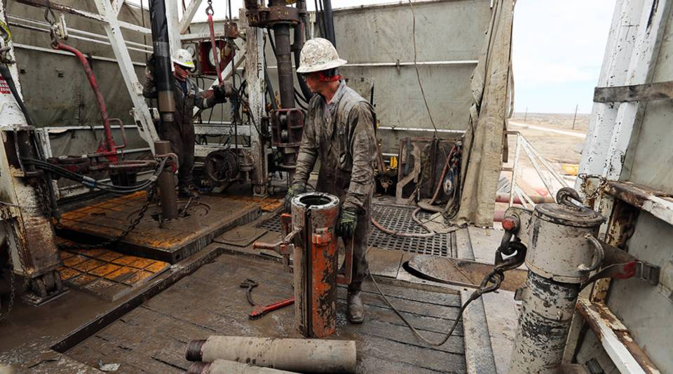 Workers on an oil rig in Midland, Texas, part of the Permian Basin, where output has tripled in the past three years.