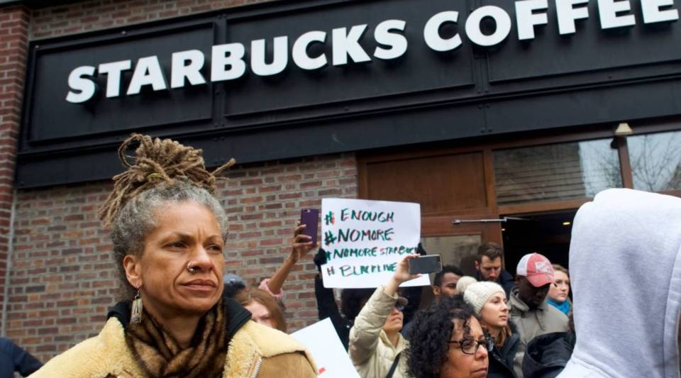 Protester Michelle Brown, 50, (L) demonstrates outside a Center City Starbucks on Sunday in Philadelphia, Pennsylvania. Police arrested two black men who were waiting inside the Center City Starbucks, which prompted an apology from the company's CEO.
