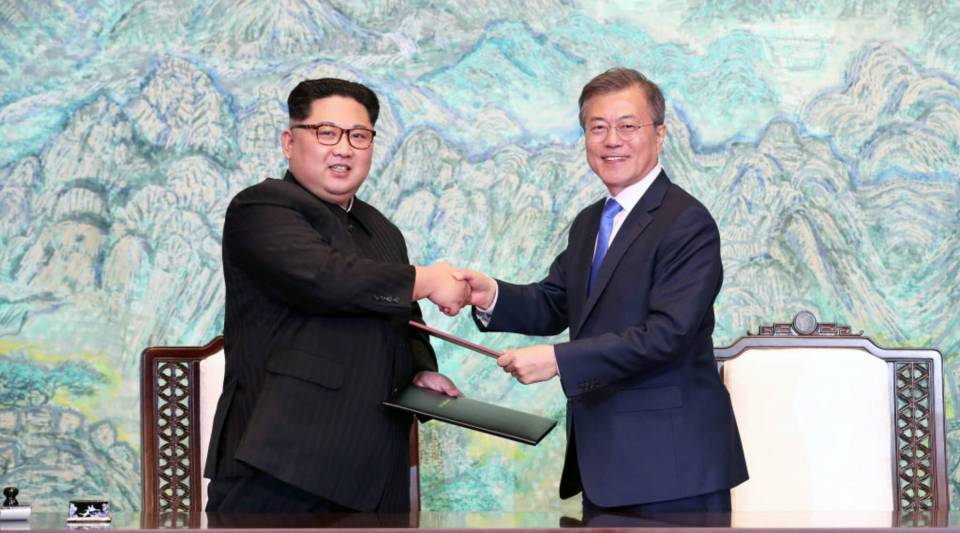 "North Korea's leader Kim Jong Un (L) and South Korea's President Moon Jae-in (R) exchange documents during a signing ceremony near the end of their historic summit at the truce village of Panmunjom on Friday. The leaders of the two Koreas held a landmark summit after a highly symbolic handshake over the Military Demarcation Line that divides their countries, with the North's Kim Jong Un declaring they were at the ""threshold of a new history."