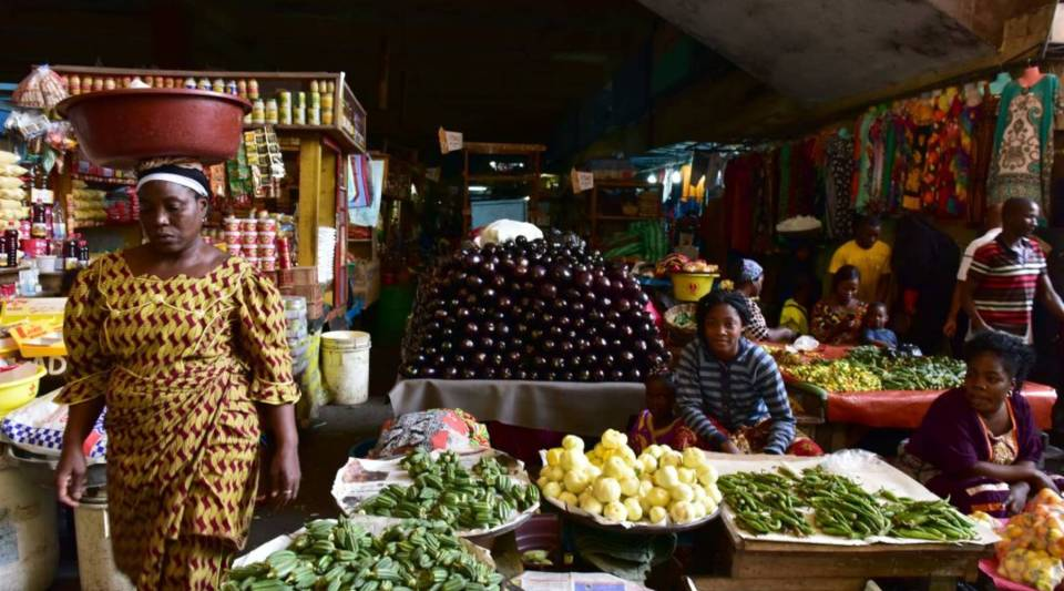 A vendor sells fruits and vegetables at the large market of Adjame, a popular district of Abidjan, Côte d'Ivoire, on Aug. 10, 2017.